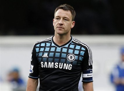John Terry of Chelsea looks over at the Queens Park Rangers fans as they chant insults at him during an injury break in their FA Cup soccer