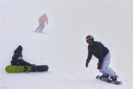 Holiday-makers ski and snowboard on Mount Hermon in the Golan Heights, some 500 metres from Israel's border with Syria