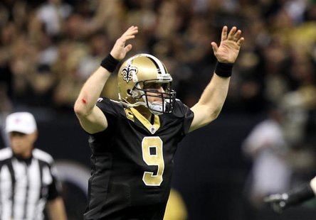 New Orleans Saints quarterback Drew Brees celebrates after a touchdown to Robert Meachem against the Detroit Lions in the fourth quarter dur