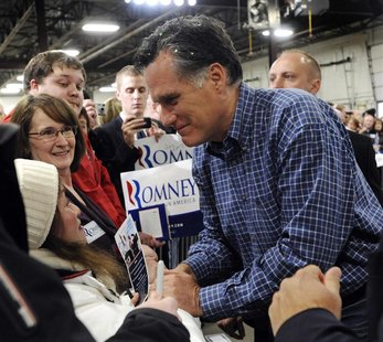 U.S. Republican presidential candidate Romney shakes hands as he mingles with the crowd at a campaign stop in Eagan