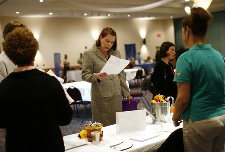 A woman reads an application at a job fair