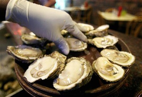 Fresh oysters sit on a counter awaiting consumption at Felix's Seafood Restaurant in New Orleans