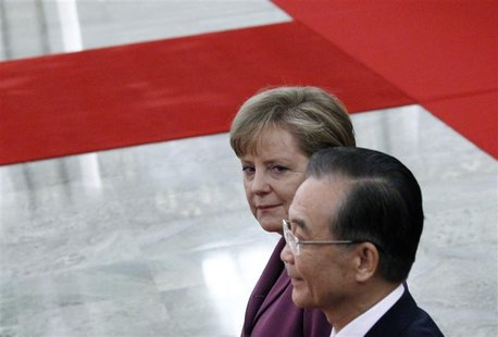 German Chancellor Merkel walks next to Chinese Premier Wen during an official welcoming ceremony in the Great Hall of the People in Beijing