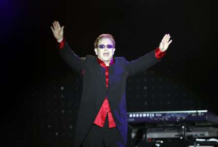 British singer Elton John greets his fans before his concert in Istanbul July 5, 2011. REUTERS/Osman Orsal (TURKEY - Tags: SOCIETY ENTERTAINMENT PROFILE)