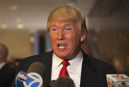 Donald Trump speaks to members of the media after a meeting with Republican presidential candidate Newt Gingrich at Trump Towers on 5th Avenue in New York, December 5, 2011. Credit: Reuters/Andrew Burton
