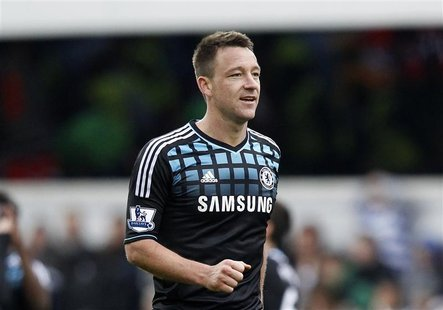 John Terry of Chelsea celebrates after his team beat Queens Park Rangers in their FA Cup soccer match at Loftus Road in London