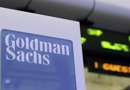 A Goldman Sachs sign is seen on at the company's post on the floor of the New York Stock Exchange