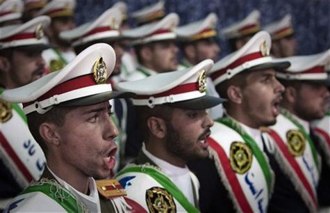 Iranian soldiers sing national anthems during the anniversary ceremony of Iran's Islamic Revolution at the Khomeini shrine in the Behesht Za