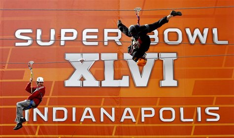 Fans ride on a zip line in downtown Indianapolis, ahead of the NFL's Super Bowl XLVI football game