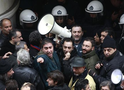 Health sector personnel shout slogans during a protest against austerity measures outside Health Ministry in Athens