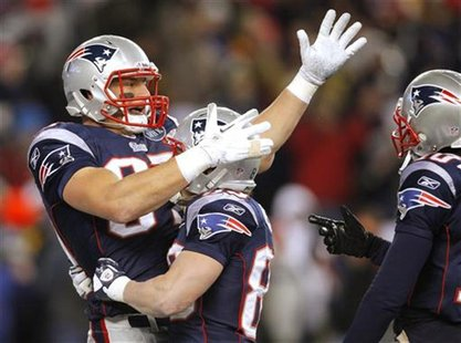 New England Patriots Gronkowski celebrates with teammates Welker and Underwood in their NFL AFC Divisional playoff football game in Foxborou