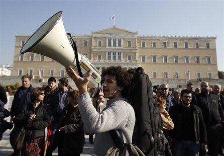 Protesters from PAME march during a rally in front of the parliament in Athens