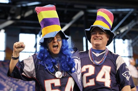 New England Patriots fans enjoy themselves inside Lucas Oil Stadium before the start of the NFL Super Bowl XLVI football game against the Ne