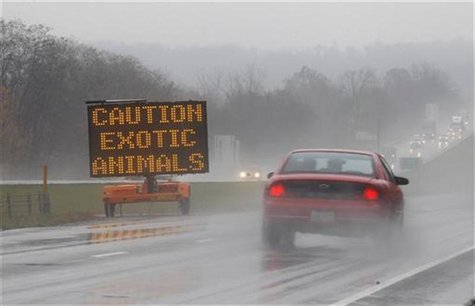 A sign posted on Interstate 70 warns drivers of animals loose in the area around Zanesville