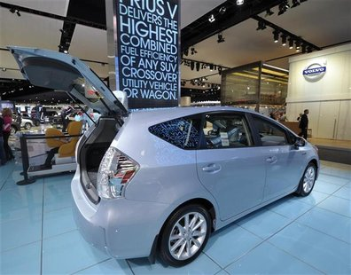 A 2013 Toyota Prius V hybrid is displayed on the final press preview day for the North American International Auto Show in Detroit