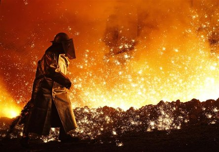 A worker controls the cast at a blast furnace of German steel manufacturer Salzgitter AG in Salzgitter