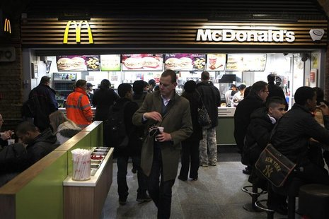Customers are served at a Mcdonald's fast food restaurant in London