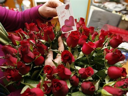 A florist prepares roses for Valentine's Day at a flower shop in Tirana
