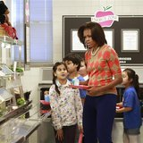 U.S. First Lady Michelle Obama joins the lunch line at Parklawn Elementary School in Alexandria, Virginia
