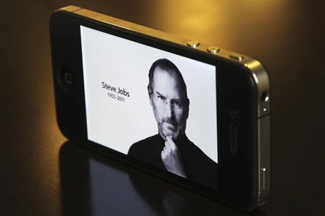 The main Apple Inc website featuring Apple co-founder Steve Jobs is seen on an iPhone in this photo illustration taken in Central Sydney