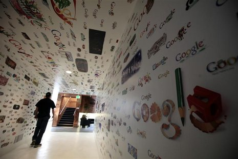A man walks through a tunnel of Google homepage logos at the Google campus near Venice Beach, in Los Angeles