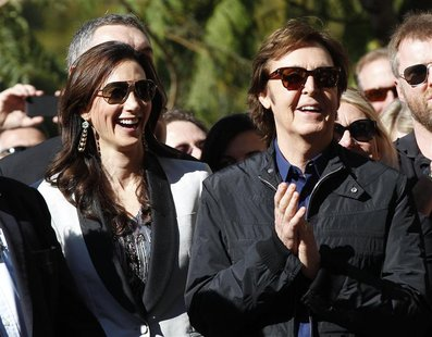 McCartney applauds next to his wife Nancy Shevell before unveiling his star on the Walk of Fame in Hollywood