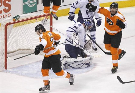 Flyers center Giroux and Flyers winger Jagr celebrate Girouxs goal against the Maple Leafs goalie Reimer during their NHL ice hockey game in