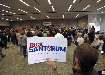 A supporter holds a sign as Republican presidential candidate Rick Santorum speaks at a rally in Minnesota