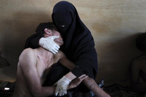 Aranda of Spain has won World Press Photo of the Year 2011 with this picture of woman holding wounded relative during protests against presi