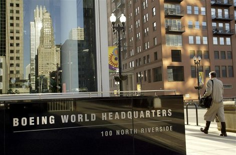 A pedestrian walks past the Boeing World Headquarters office building in Chicago April 26, 2006.