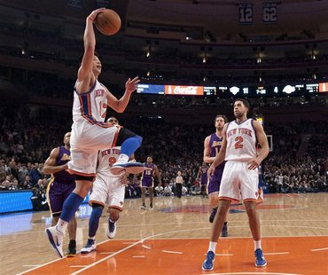 New York Knicks' Lin drives for layup as Los Angeles Lakers' Gasol and Knicks' Fields watch in NBA game in New York
