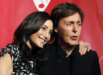 Paul McCartney and his wife Nancy Shevell pose at the 2012 MusiCares Person of the Year tribute honoring McCartney in Los Angeles