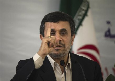 Iranian President Mahmoud Ahmadinejad gestures while speaking at the 25th International Islamic Unity Conference in Tehran