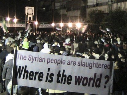 Demonstrators gather during a protest against Syria's President Bashar al-Assad in Homs