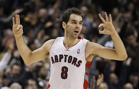 Raptors Calderon celebrates a three point shot against the Lakers during their NBA basketball game in Toronto