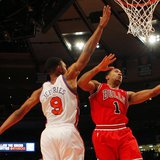 Chicago Bulls' Rose drives to the basket past New York Knicks ' Jeffries during their NBA game in New York