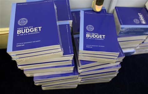Copies of U.S. President Barack Obama's Fiscal Year 2013 budget are seen stacked inside the House Budget Committee room on Capitol Hill in W