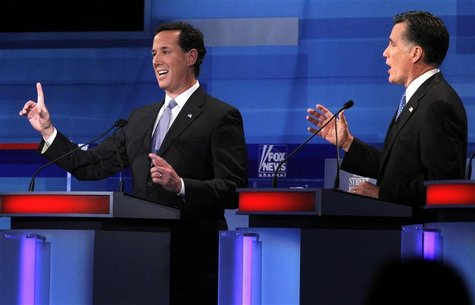 Republican presidential candidates Santorum and Romney discuss a point during a Republican presidential candidates debate in Myrtle Beach