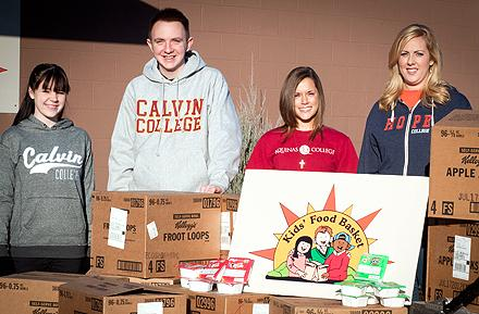 "Students from Hope, Calvin and Aquinas colleges who participated in ""Share The Bowl"" campaign in which Kellogg's donated 228 cases of cereal to West Michigan food banks."