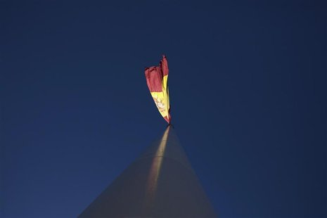 The Spanish flag flutters over the Colon square in central Madrid