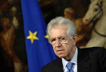 ItalianPM Monti looks on during a meeting with Secretary General of the Organization for Economic Cooperation and Development Angel Gurria a