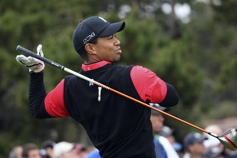 Woods drops his driver while teeing off on the 10th hole during the final round of the Pebble Beach National Pro-Am