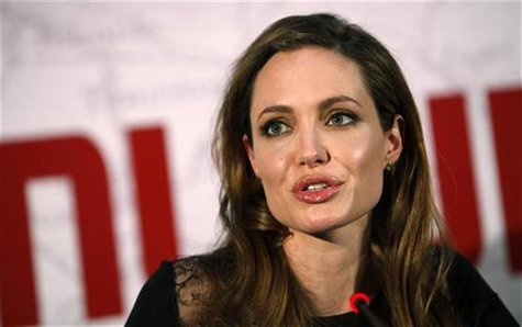"U.S. actress and director Angelina Jolie speaks during a news conference before the gala premiere of the movie ""In The Land Of Blood And Hon"