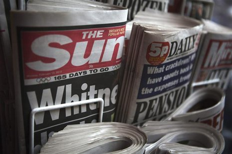 Copies of The Sun newspaper are displayed at a kiosk in London