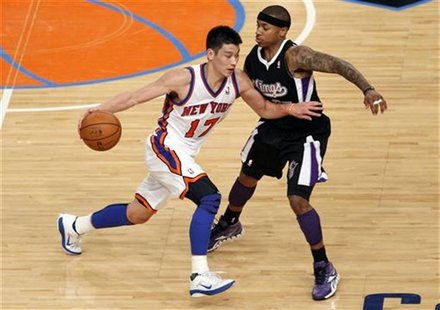 Knicks' Lin drives into Kings' Thomas during third quarter of their NBA basketball game in New York
