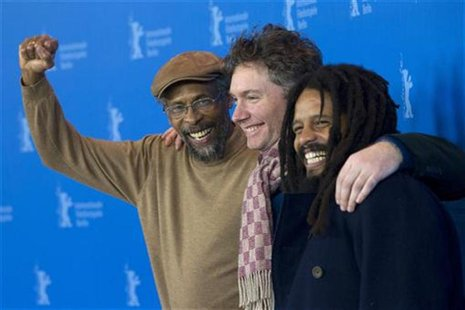 "Artist Garrick, protagonist Marley and director Kevin Macdonald pose during a photocall promoting movie ""Marley"" at Berlinale International"