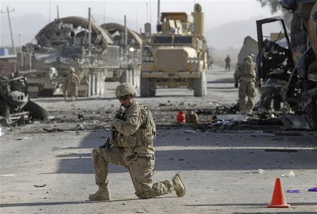 A U.S. soldier keeps watch at the site of an explosion in Kandahar
