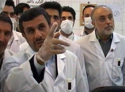 Still image taken from video shows Iran's President Ahmadinejad watching from a control room as nuclear fuel rods are loaded into the Tehran