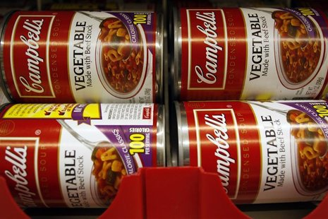 Cans of vegetable Campbell's Condensed Soup are stocked on a shelf at a grocery store in Phoenix