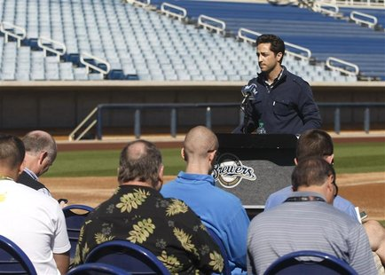 Milwaukee Brewers left fielder Ryan Braun acknowledges the media and teammates after winning an appeal of a positive drug test and 50-game s